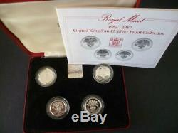 1984-1987 Uk Royal Mint Four Coin Silver Proof £1 Coin Coin Set Housed Red Case